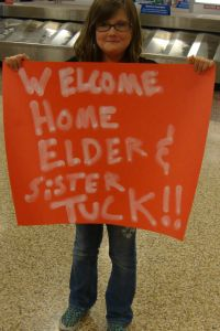 Elsie with Welcome Sign