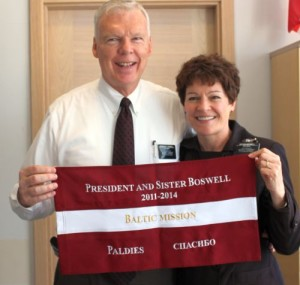 President and Sister Boswell with the Latvian Flag